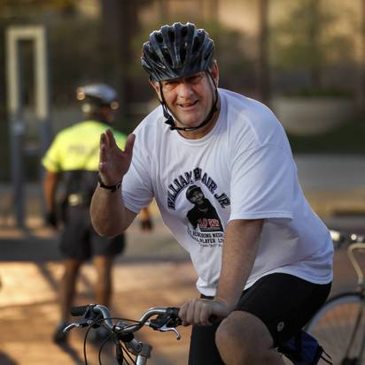 Mayor Mike rides a bicycle